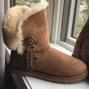Brown Ugg's with golden button on side